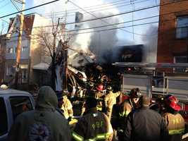 Pittsburgh firefighters battle a fire and collapse on Friendship Ave