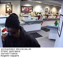 Police have released these surveillance pictures from a robbery at First Commonwealth Bank on South Braddock Avenue in Edgewood.