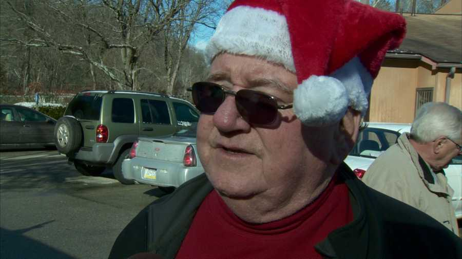 Steelers play-by-play man Bill Hillgrove traded in his black and gold for red and white to help hand out toys to children on Christmas Eve.