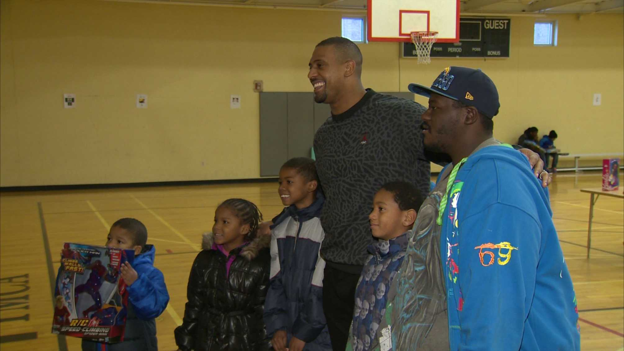 Steelers linebacker LaMarr Woodley got in the holiday spirit while throwing a party on Christmas Eve for 100 kids and their families at the Homewood-Brushton YMCA.