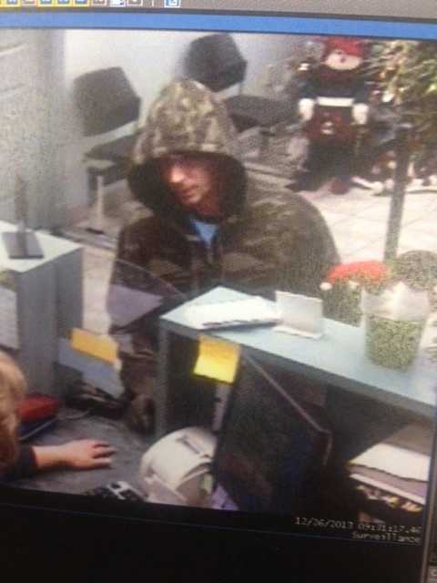 Police in New Castle are hoping surveillance images will lead them to a man who claimed to have a gun when he robbed a bank Thursday morning.