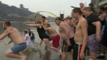 A crowd of Pittsburghers welcomed the new year with a big splash Wednesday. They jumped into the Mon River as part of the Pittsburgh Polar Bear Club's annual plunge.