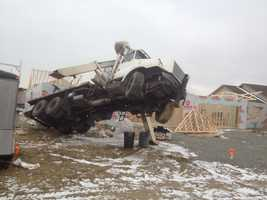 A crane tipped onto a house that was under construction in Plum on Thursday morning.