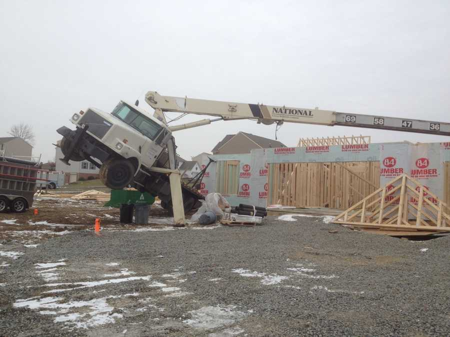 The operator got out of the crane before it tipped completely and was not hurt.