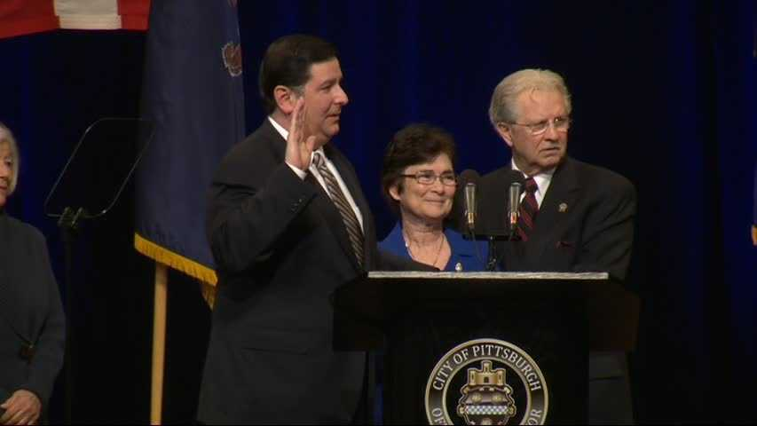 Bill Peduto was sworn in as the 60th mayor of Pittsburgh. The parents of slain police officer Paul Sciullo stood with Peduto as he took his oath.