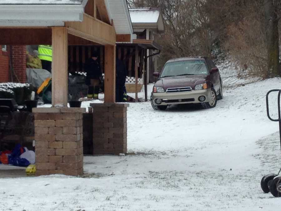Ross Township police said a car went over a 30-foot embankment and hit a house below the driver's home Wednesday morning.