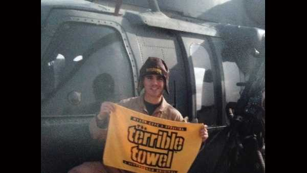 Air Force Capt. Sean Ruane holds a Terrible Towel.