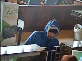 Police said the armed robbery happened about 12:12 p.m. at the Huntington Bank in the 100 block of East Washington Street.
