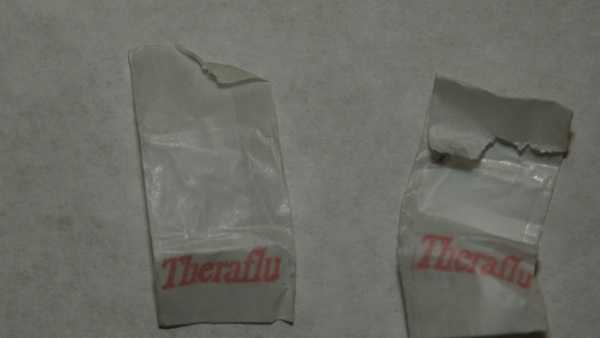 "Heroin bags stamped with the word ""Theraflu."""