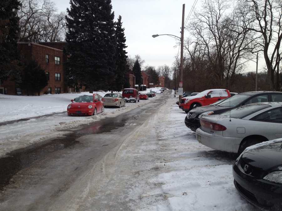 The cars are stuck in thick ice on Pyramid Avenue in Brentwood.