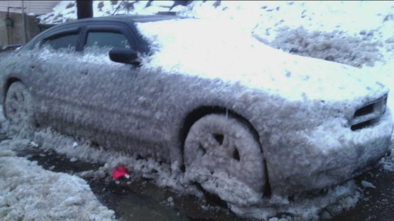 Arctic blast, water main breaks leave cars frozen to street
