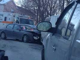 A car and a school van got into a crash on a narrow road in Carrick.