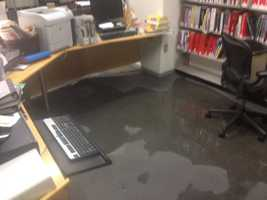 Water spilled into the lower level of the library, where there are books, business materials, public computers and some historic documents that may be damaged.