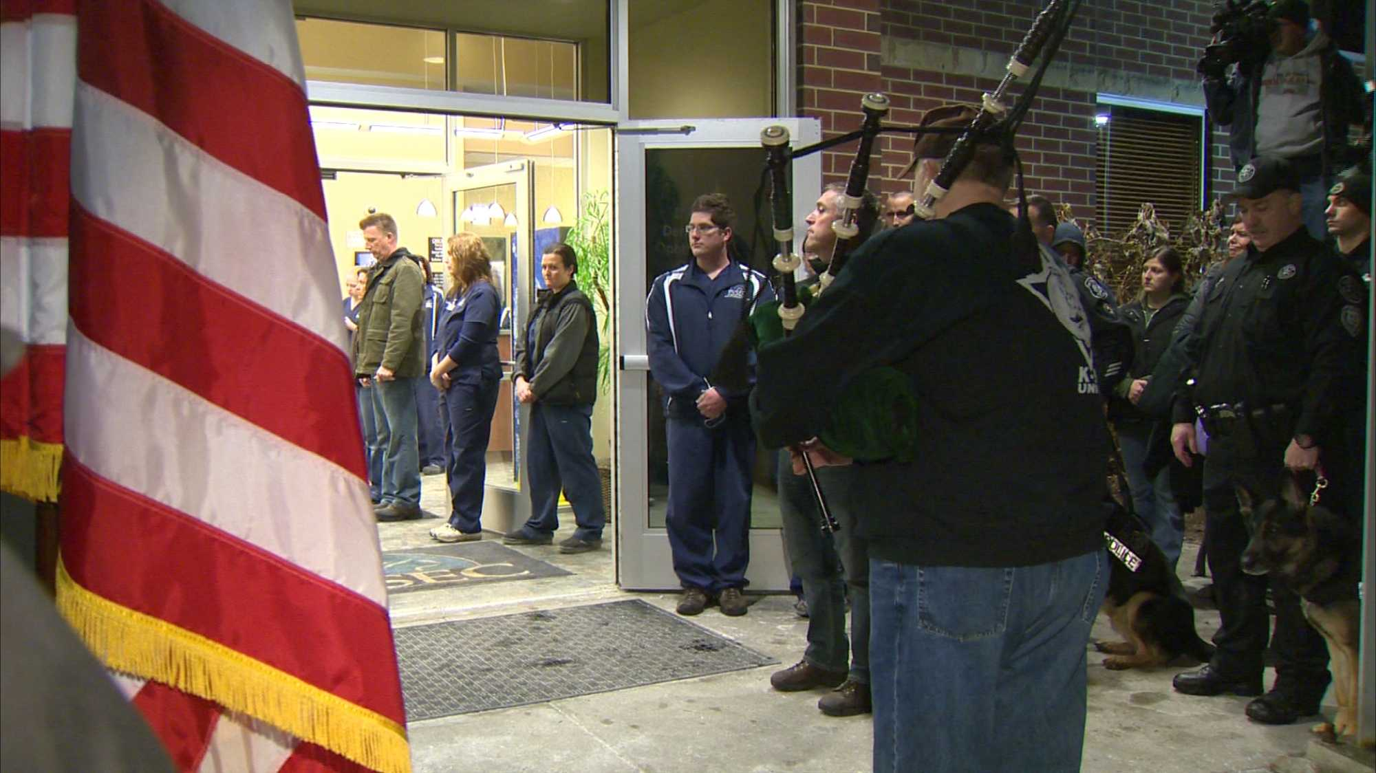 With an American flag draped over his coffin, Rocco's body was escorted out of the Pittsburgh Veterinary Specialty Emergency Center by his fellow officers while others stood close by and saluted the K-9. (Click HERE to watch video)