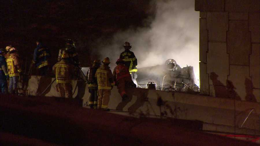 The vehicle rolled onto its roof in a grassy median and burst into flames.
