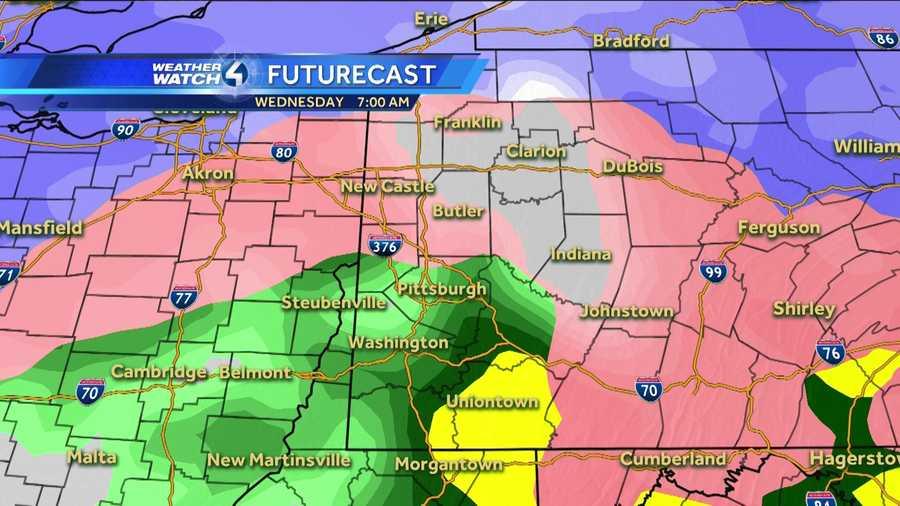 Wednesday 7 a.m. (White represents snow. The deeper the purple, the heavier the snowfall. Pink=ice/sleet/freezing rain. Green=rain. Yellow=heavy rain.)