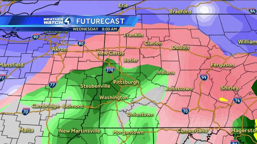 Wednesday 8 a.m. (White represents snow. The deeper the purple, the heavier the snowfall. Pink=ice/sleet/freezing rain. Green=rain. Yellow=heavy rain.)