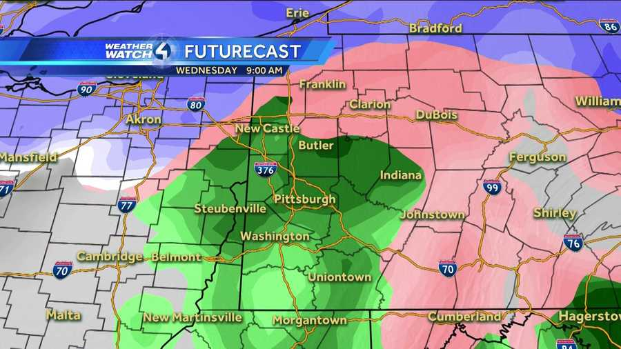 Wednesday 9 a.m. (White represents snow. The deeper the purple, the heavier the snowfall. Pink=ice/sleet/freezing rain. Green=rain. Yellow=heavy rain.)