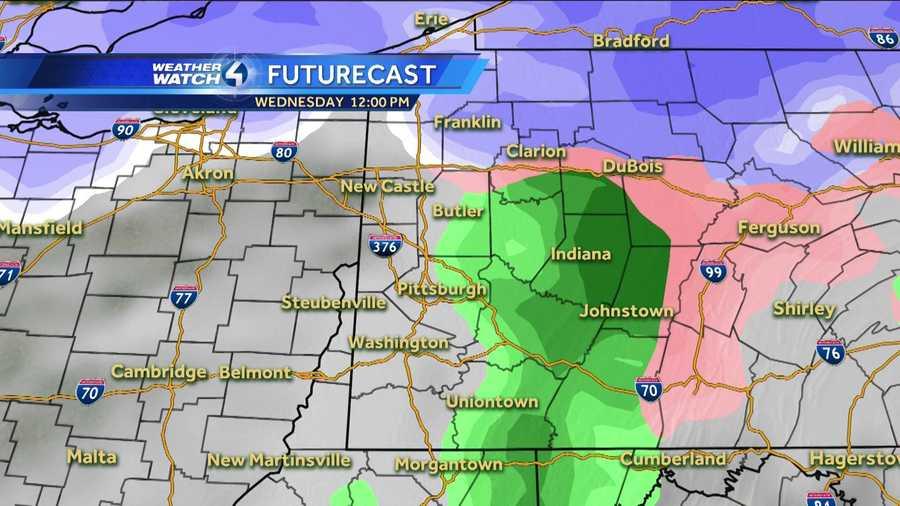 Wednesday 12 p.m. (White represents snow. The deeper the purple, the heavier the snowfall. Pink=ice/sleet/freezing rain. Green=rain. Yellow=heavy rain.)