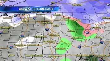 Wednesday 1 p.m. (White represents snow. The deeper the purple, the heavier the snowfall. Pink=ice/sleet/freezing rain. Green=rain. Yellow=heavy rain.)