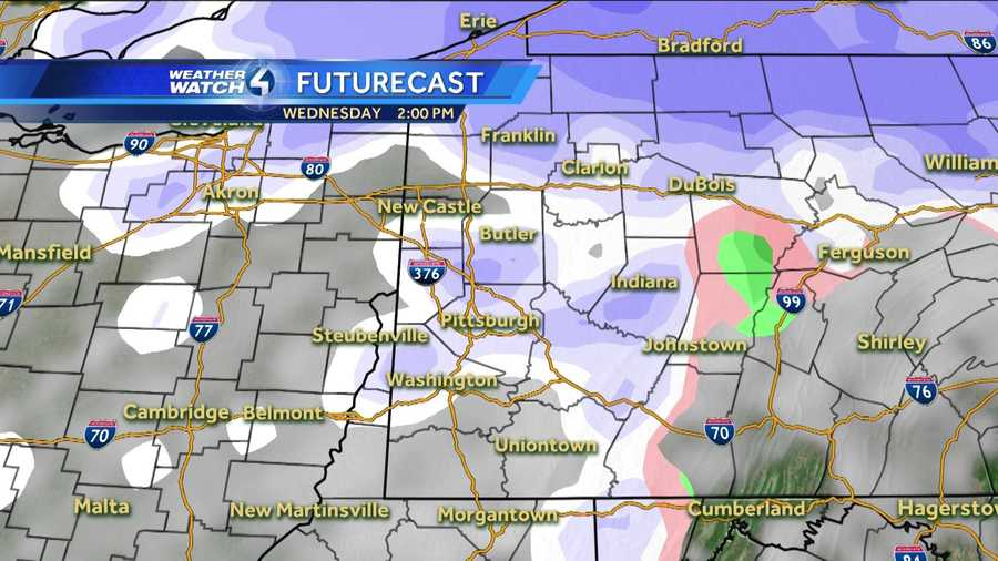 Wednesday 2 p.m. (White represents snow. The deeper the purple, the heavier the snowfall. Pink=ice/sleet/freezing rain. Green=rain. Yellow=heavy rain.)