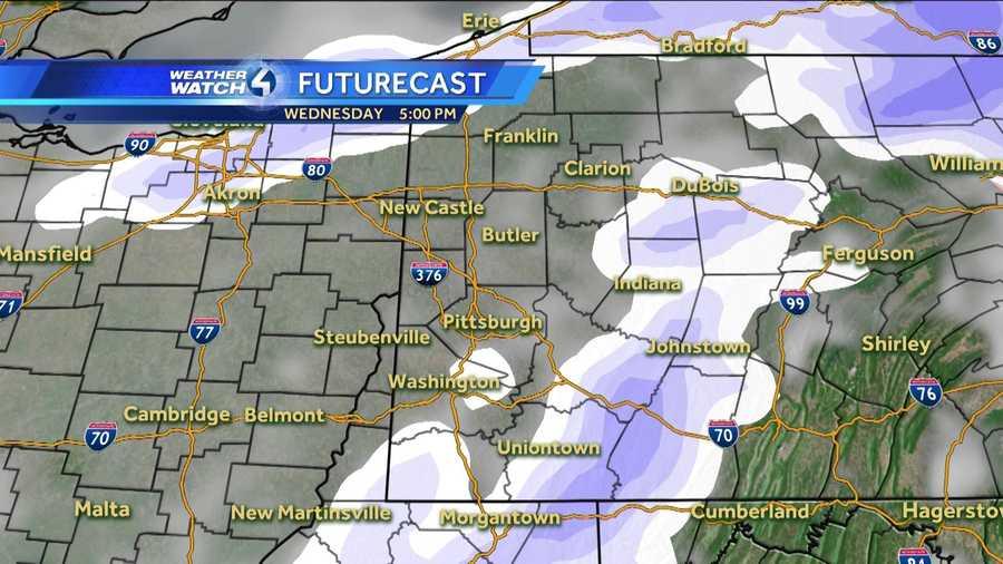 Wednesday 5 p.m. (White represents snow. The deeper the purple, the heavier the snowfall. Pink=ice/sleet/freezing rain. Green=rain. Yellow=heavy rain.)