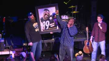 Harrison took bids from the crowd on an autographed portrait of Keisel.