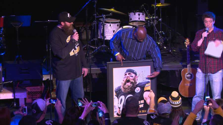 Former Steelers linebacker James Harrison made a surprise appearance as a guest auctioneer.