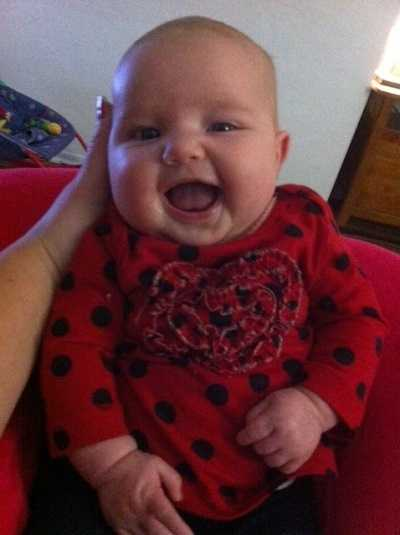 10 week old Baby Claire wearing her red heart shirt to support a healthy heart!