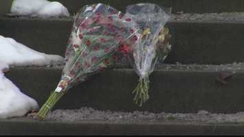 Flowers were left on the steps of their home at 701 Chislett St.
