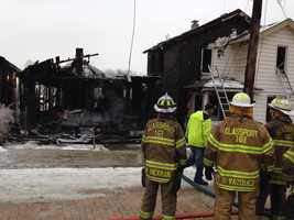 Firefighters battled a three-alarm blaze that gutted three houses Thursday morning in Swissvale.