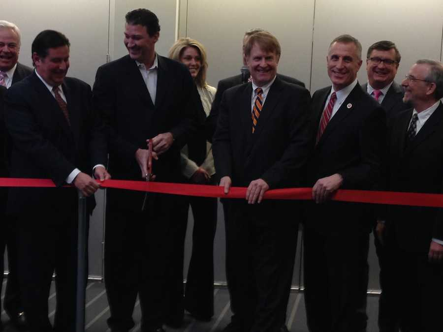 Mayor Bill Peduto, Mario Lemieux, Allegheny County Executive Rich Fitzgerald and U.S. Rep. Tim Murphy participate in the ribbon cutting at the 2014 Red CARpet Charity Preview Gala at the David L. Lawrence Convention Center.