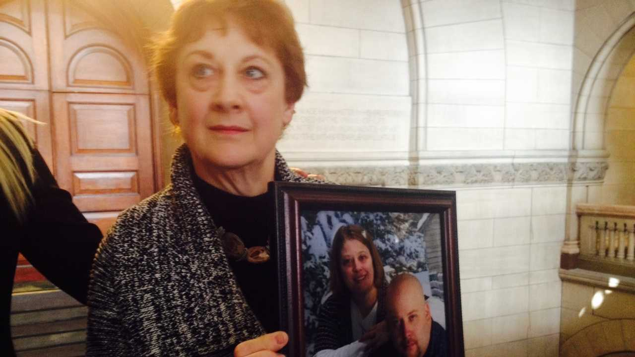 Ann Haines holds a picture of her son, Michael, and his sister.