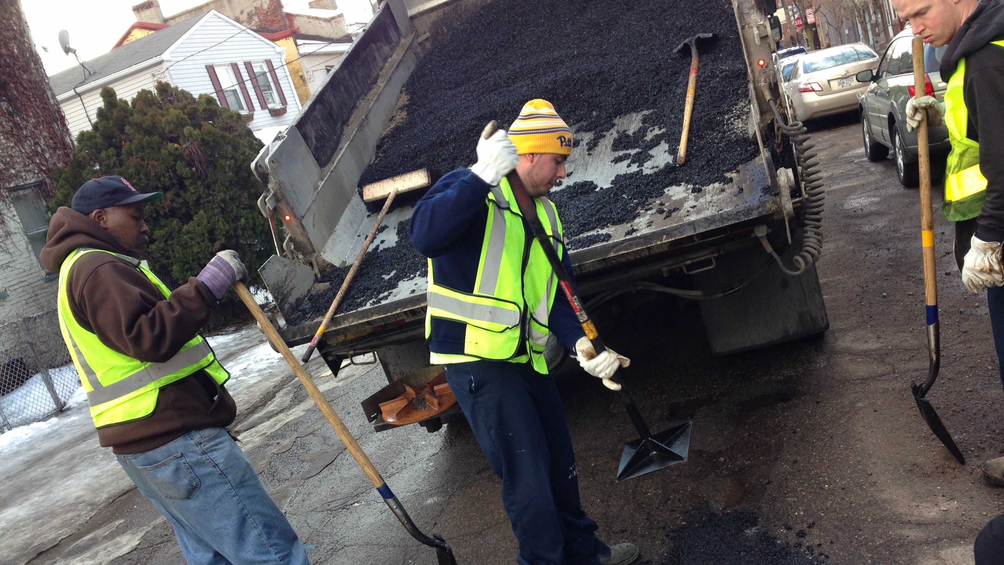 A pothole is filled on 43rd Street in Lawrenceville.