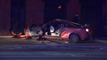 One car hit a building and was heavily damaged. Two people were taken to the hospital, where one of them died.