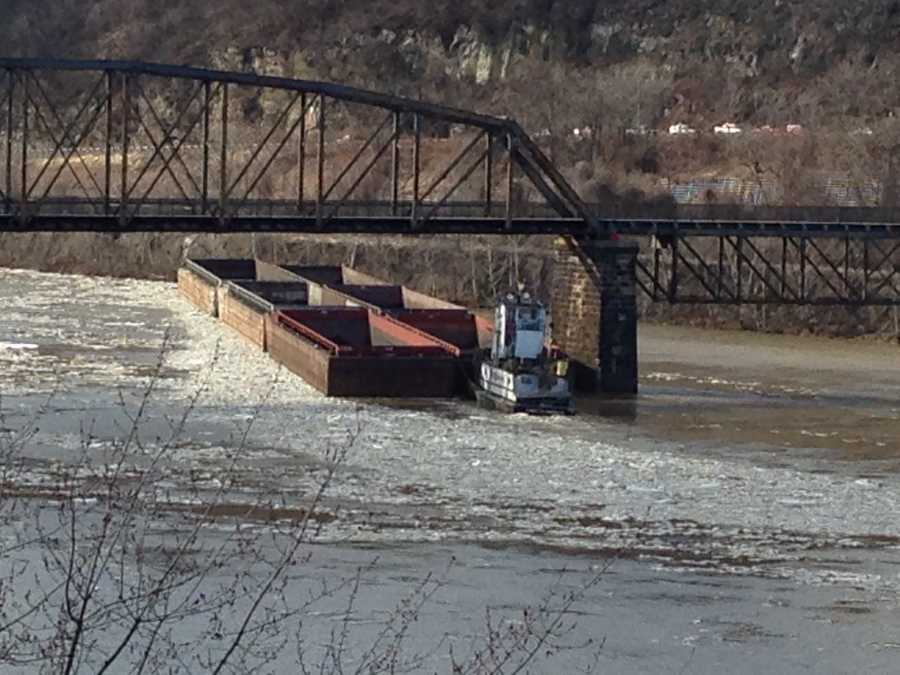 A barge in the Monongahela River got stuck against the pillar of an old railroad bridge near the McKeesport-Duquesne Bridge on Friday afternoon.