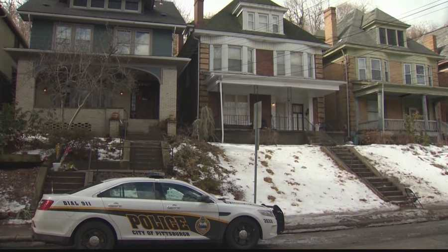 """Feb. 21: Two weeks after the Wolfe sisters were found dead, police remain vigilant outside the home where the """"person of interest"""" lives."""