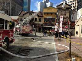 A fire in Market Square damaged Bruegger's Bagels, Perle and Nola On the Square.