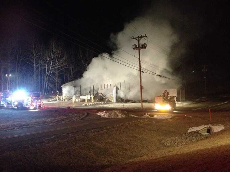 Firefighters say a road maintenance building in Industry Borough Community Park was engulfed by flames when they arrived.