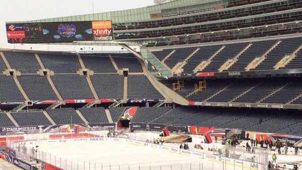 A hockey rink is set up inside Soldier Field in Chicago for the Penguins-Blackhawks game in the NHL Stadium Series.