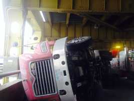 A tractor-trailer hit a car in a rollover crash on the Fort Pitt Bridge.