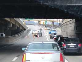 Ramps to the outbound Fort Pitt Bridge were closed after a tractor-trailer crashed on the lower deck.