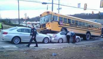 Police said the school bus was turning left from Route 8 onto East Hardies Road when it was struck by a black pickup truck, and the impact pushed the bus over while it was still moving, so it went on top of the car, which was stopped at the traffic light.