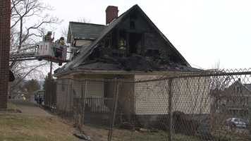 Two neighbors pulled a man from a burning home Friday afternoon in Uniontown.