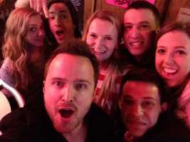 """Fathers and Daughters"" stars Aaron Paul and Amanda Seyfried took a selfie with Justin Long and @alliesmitha at Jack's Bar on the South Side."