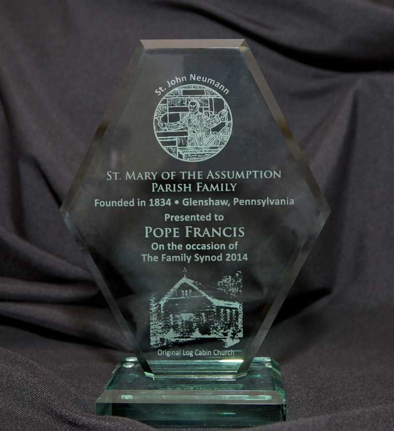 A glass commemorative etching from St. Mary of the Assumption, the Corbetts' home parish in Glenshaw, was given to Archbishop Vincenzo Paglia to be presented to Pope Francis. Paglia is the president of the Pontifical Council for the Family, which is helping organize the World Meeting of Families in Philadelphia.