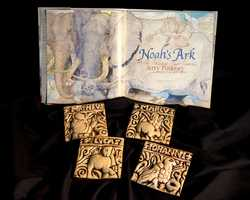 """Four ceramic tiles representing the gospels of Matthew, Mark, Luke and John, made at the Moravian Pottery and Tile Works in Doylestown, Pa.A first-edition copy of the """"Noah's Ark"""" children's book by Philadelphia artist Jerry Pinkney, who inscribed it """"For His Holiness Pope Francis"""" and drew the dove of peace."""
