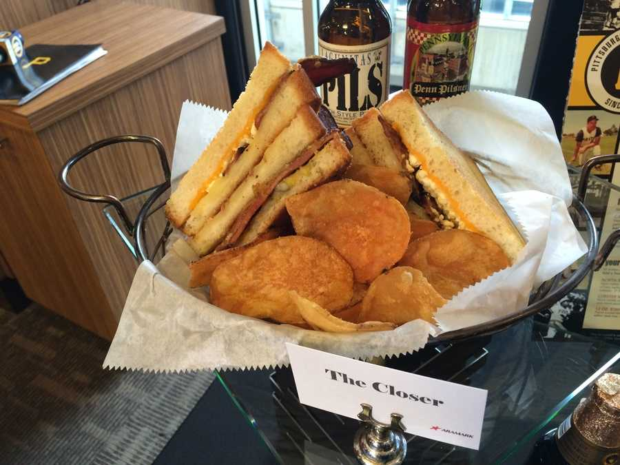 """""""The Closer"""" is an overstuffed grilled cheese sandwich with four slices of thick-cut sourdough bread, nine different cheeses, candied bacon and a leek and Granny Smith apple compote."""
