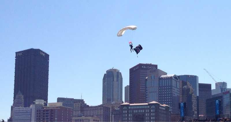 The Jolly Roger arrives via parachutist before the US Flag