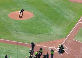 Fallen Pittsburgh Police K-9 Rocco's handler threw out the first pitch.